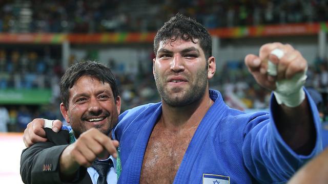 Sasson, celebrating with coach Oren Smadja. (Photo: Oren Aharoni)