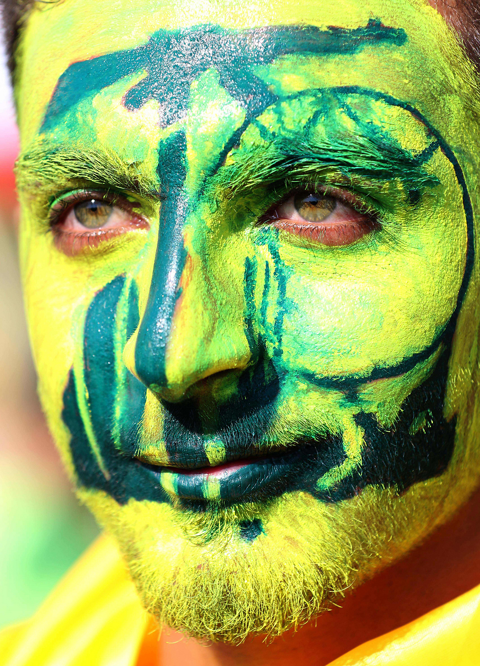 A Hezbollah supporter has his face painted with the Hezbollah logo (Photo: AFP)