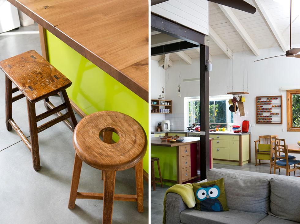 במטבח אי עשוי עץ וצבוע ירוק ובורדו, ובצדו שרפרפים מקוריים. ארונות המטבח צבועים בצהוב. צבעוניות עזה שמכניסה עניין  (צילום: שירן כרמל)