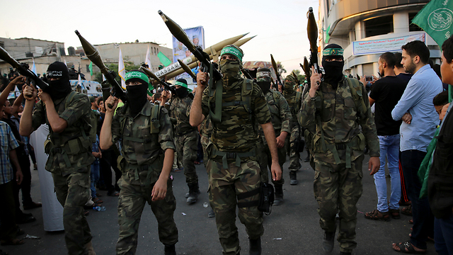 Hamas fighters on parade hours after rocket attack (Photo: AP)