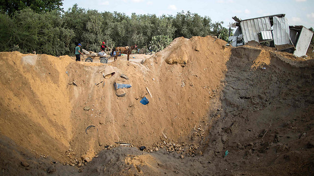 A particularly big hole in the ground, the result of the IAF strikes on August 22 (Photo: AFP)