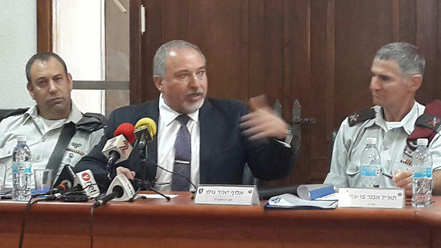 Avigdor Lieberman addressing the press