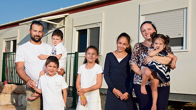 Yohan and Yael Sahal with their children at their new home in Brukhin (Photo: Tal Shahar)