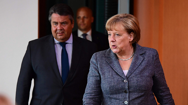 German Chancellor Merkel with Foreign Minister Gabriel, who put her in a catch-22 situation (Photo: AFP)