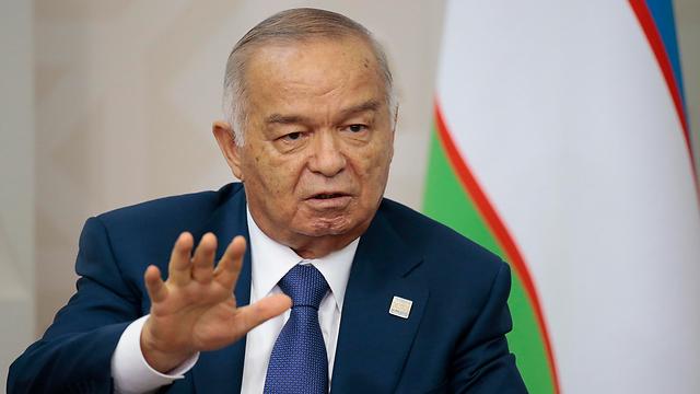 קיבל שבחים על דיכוי הקיצוניות האיסלאמית וספג ביקורת על שלטונו הרודני. קרימוב (צילום: AP) (צילום: AP)