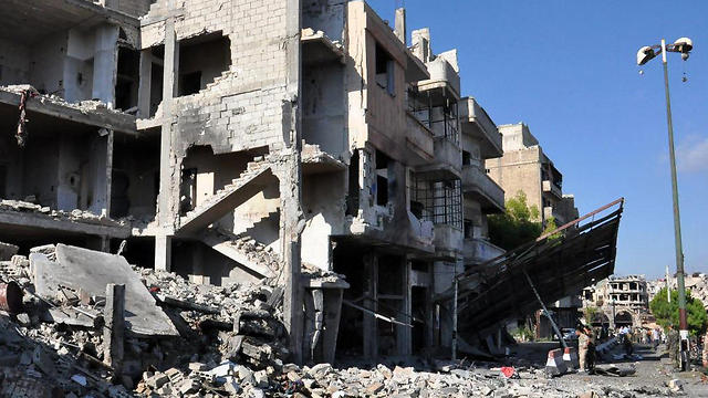 Destroyed buildings in Homs (Photo: AFP)