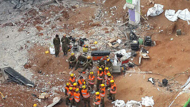 Home Front Command rescue workers at the scene of the collapse