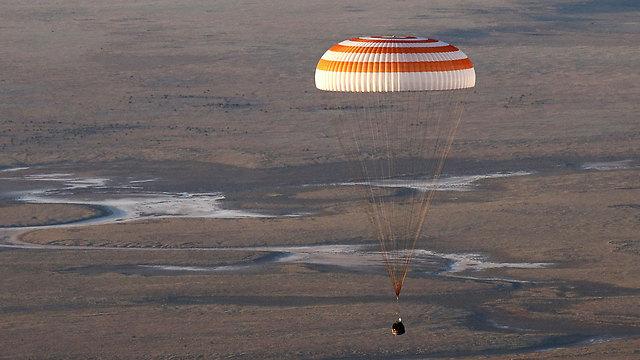 בחזרה לכדור הארץ (צילום: AP)