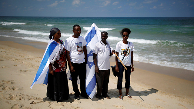 The Mengistu family holds a protest march on the Zikim beach, where Abera was last seen before crossing into Gaza (Photo: Reuters)