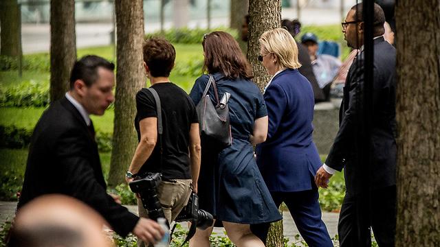 Clinton leaving the ceremony (Photo: AP)