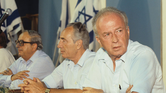 L-R: Yitzhak Navon, Shimon Peres and Rabin at a Labor Party conference in 1984 (Photo: David Rubinger)