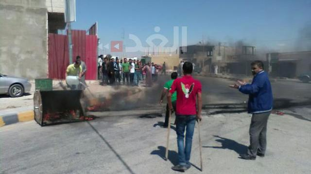 Amro family burning tires in protest Saturday