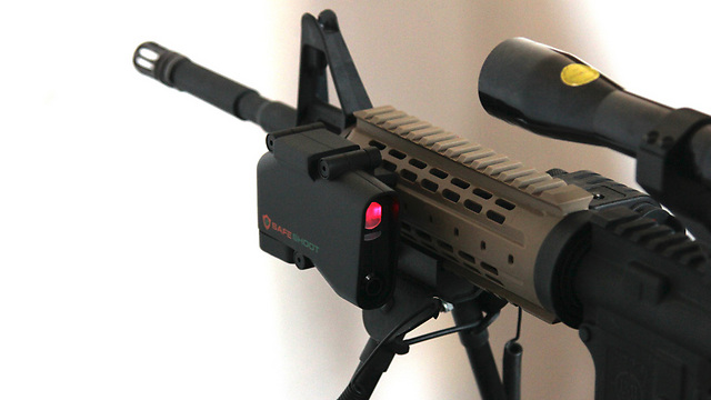SafeShoot affixed to a rifle