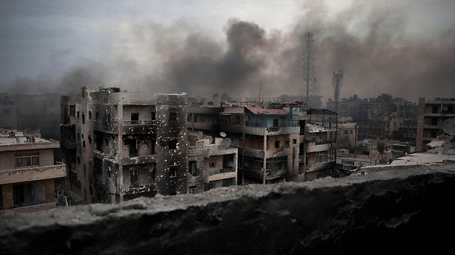 Smoke rises from a bomb in Aleppo (Photo: AP)