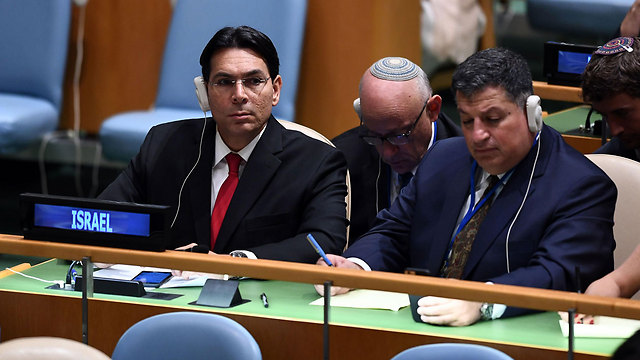 Israel's ambassador to the UN Danny Danon and Coordinator of Government Activities in the Territories Yoav Mordechai at the organization's General Assembly (Photo: AFP) (Photo: AFP)