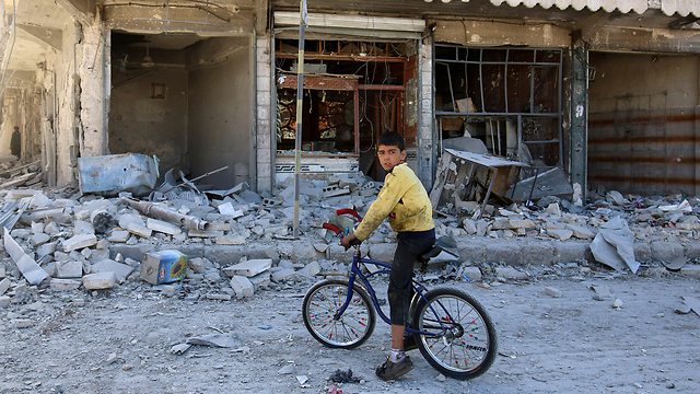 Destruction caused by regime bombs (Photo: Reuters)