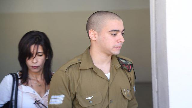 Sgt. Azaria and his mother Oshra at court (Photo: Motti Kimchi)