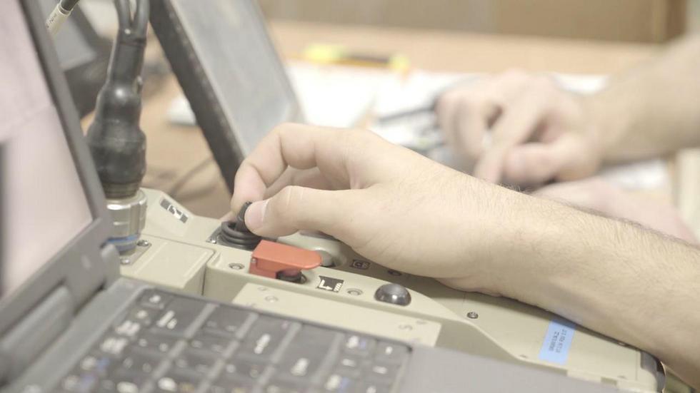 Controlling the drone using a tiny joystick (Photo: IDF Spokesman's Office)