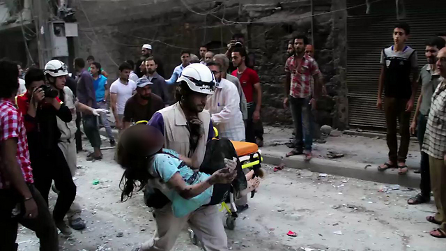 White Helmets member rescues a child