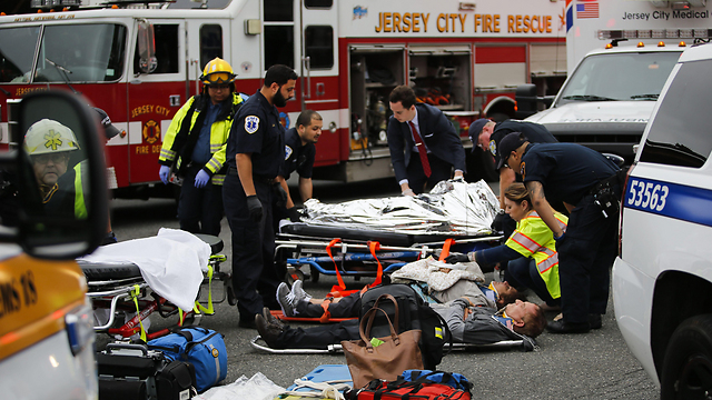 People injured in the crash being treated outside the station (Photo: AFP)