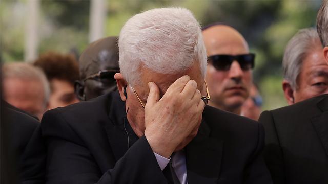 Palestinian President Mahmoud Abbas gets emotional at Shimon Peres's funeral (Photo: Gil Yohanan)