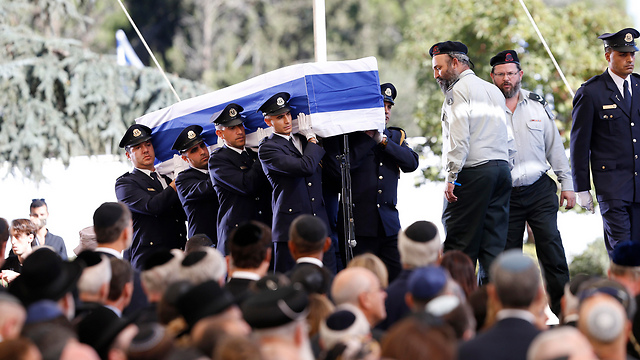 Peres's casket being carried (Photo: AP)