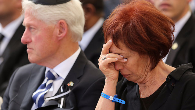 Peres's daughter, Dr. Tsvia Walden with former US President Bill Clinton (Photo: Gil Yohanan)
