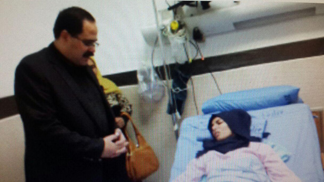 Raghad Khaddour at the hospital with Palestinian Minister of Education Dr. Sabri Saidam
