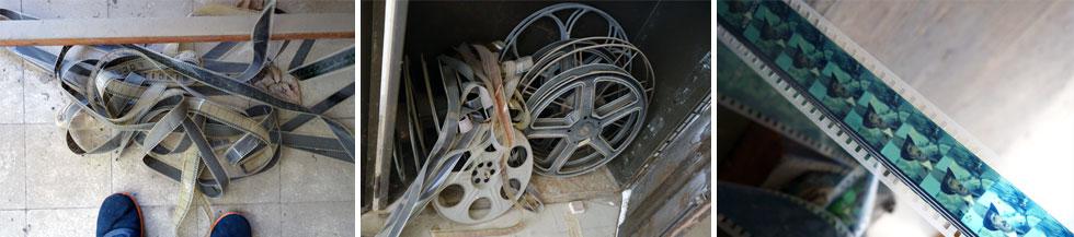 ליד המקרן פזורים גלגלי סרטים, ובאופן כללי הכל נראה שלם, כאילו לא חלפו שני מאז הסגירה (צילום: מיכאל יעקובסון)