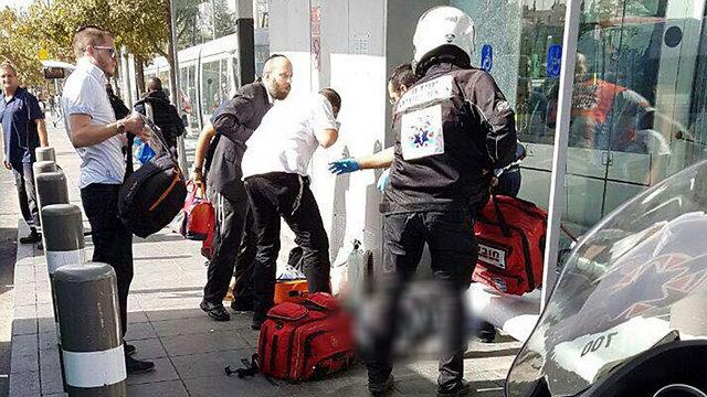 Paramedics treat victims at the scene