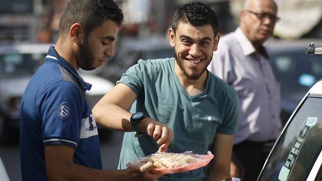 Gazans hand out sweets in celebration of the terrorist
