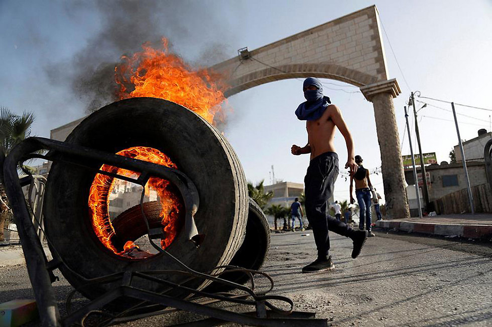 A Palestinian protest in the village of al-Ram. West Bank terrorism remained at a very low rate those years