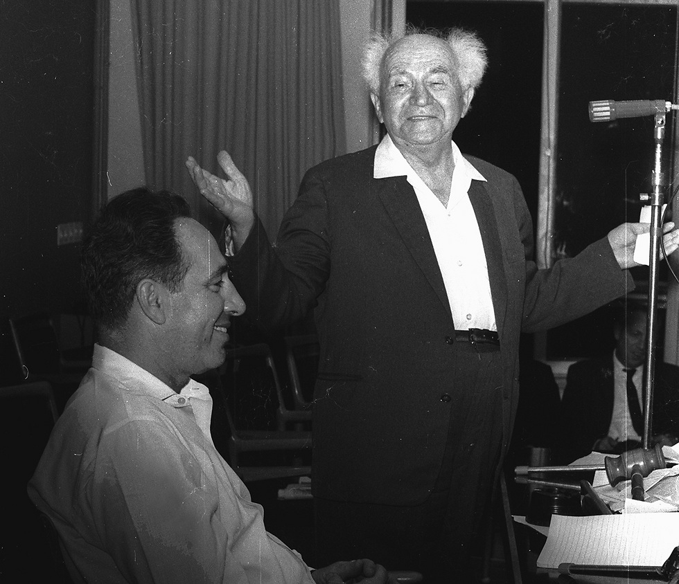 A young Peres with David Ben-Gurion (Photo: Dan Hadani/IPPA)