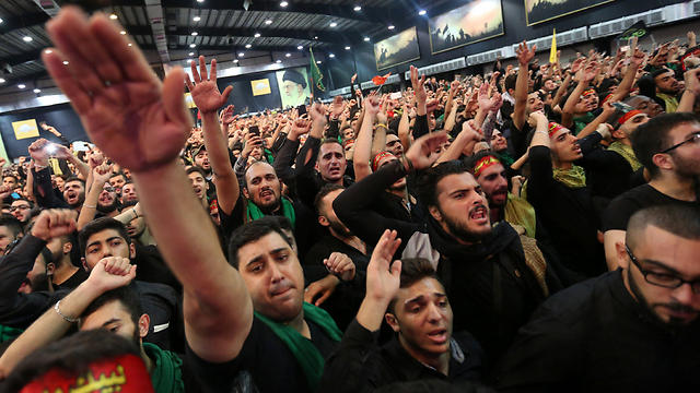 Hezbollah supporters in Beirut watch Nasrallah's speech on Tuesday (Photo: Reuters)