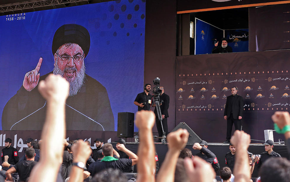 Nasrallah speaking at annual Ashura religious commemoration rally (Photo: AFP)