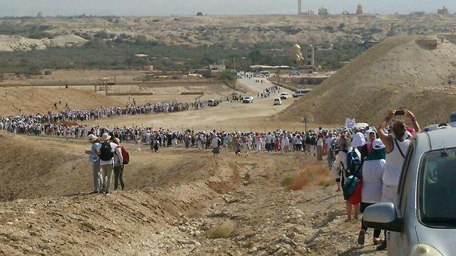 Israeli and Palestinian women march towards baptism site at Qasr el-Yahud. 'If there are many of us and if we are determined, we might manage to force the leadership to talk' (Photo: Women Wage Peace)