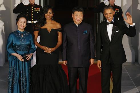 הזוג אובמה בביקור בסין (צילום: Gettyimages)
