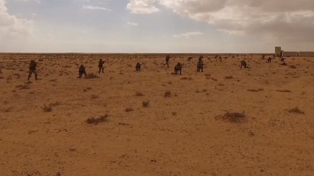 Russian and Egyptian troops prepare to storm a mock village
