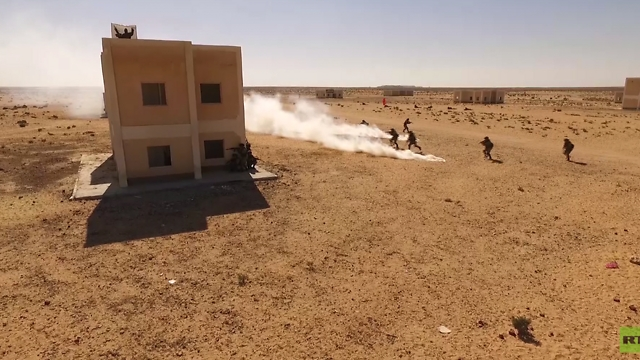 Egyptian and Russian soldiers storming a mock village outside Alexandria