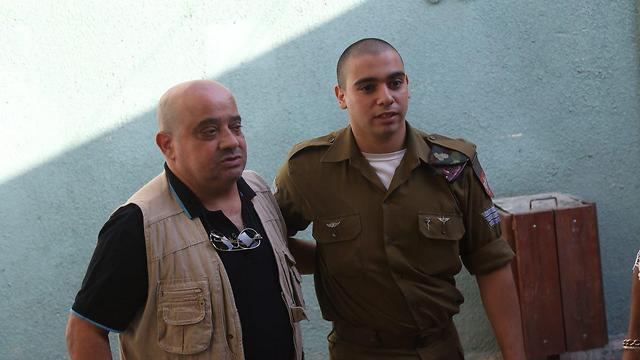 Sgt. Elor Azaria with his father Charlie in court (Photo: Motti Kimchi) (Photo: Motti Kimchi)