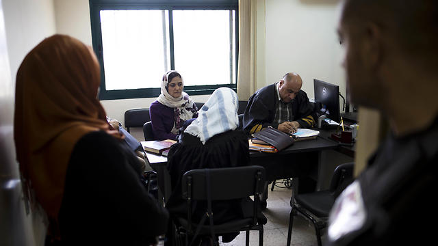 A Palestinian woman, second from left, seeking custody of her son, listens to proceedings in her case in the Islamic family court in Ramallah (Photo: AP)