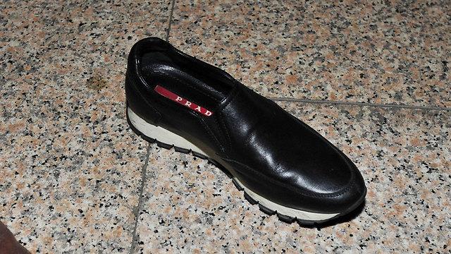 צ'וי איבדה את הנעל שלה במהלך המהומה הגדולה שנוצרה באזור בניין התובע בסיאול (צילום: EPA) (צילום: EPA)