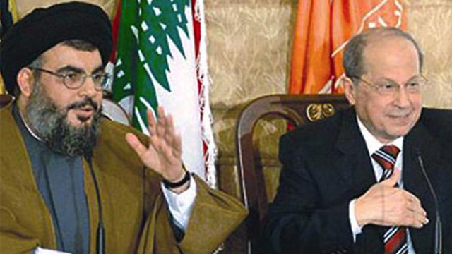 Aoun (R) and Nasrallah (File photo)