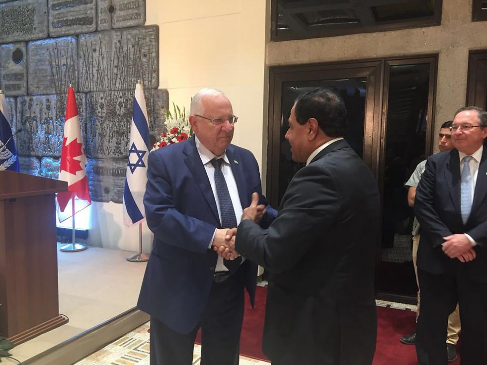 President Reuven Rivlin shakes hands with Dr. Izzadin Abu el-Aish in Jerusalem