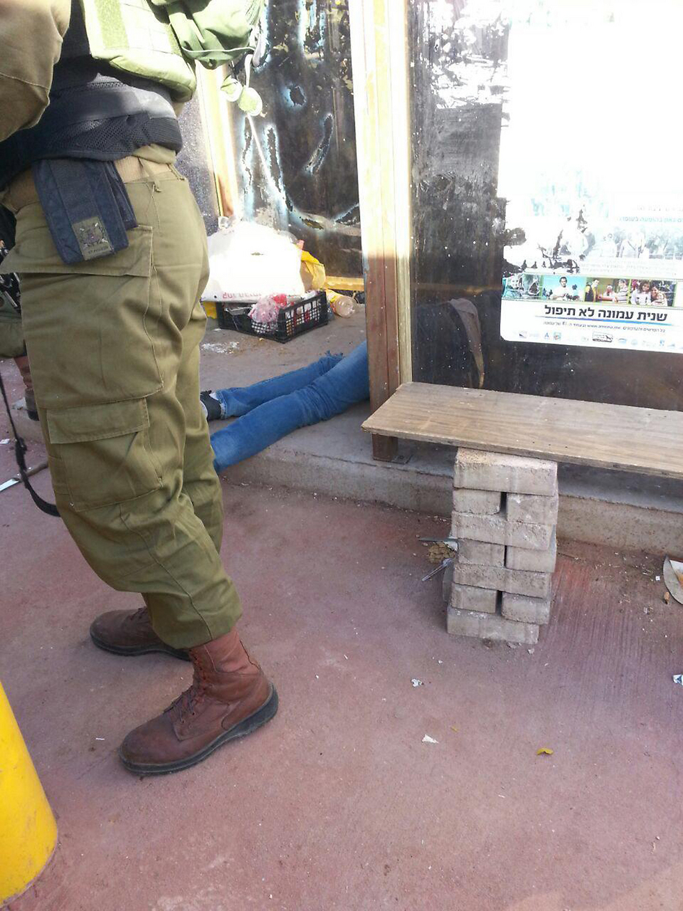 Terrorist sprawled on the floor after being shot to death (Photo: Ofra Youth)