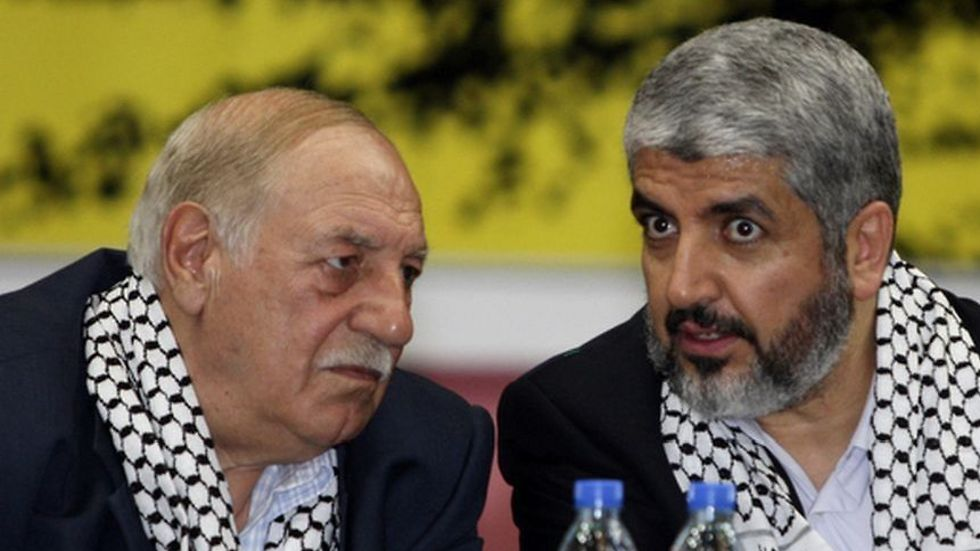 Ahmed Jibril, left, with Hamas leader Khaled Mashal (Photo: Reuters)
