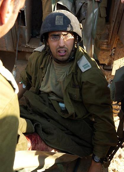 Brothers for Life member Avishai Iraki, immediately after being wounded in his leg in 2006