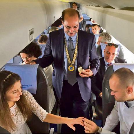 Wedding ceremony on a plane (Photo: Natan Ortzki)