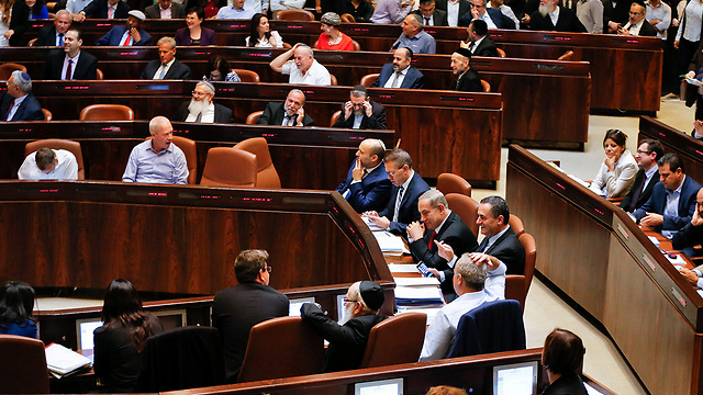 The Knesset votes on the Regulation Bill. The ammunition they are giving the anti-Israel campaign is priceless (Photo: Reuters)