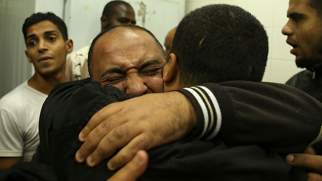 Relatives react after seeing the body of Mohammed Abu Saada (Photo: AFP)